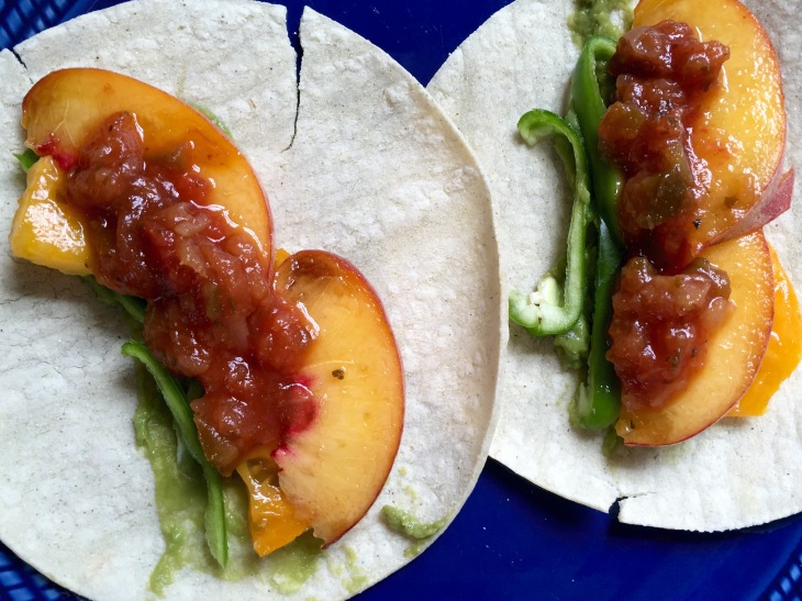 Hot pepper-tomato-peach taco assembling